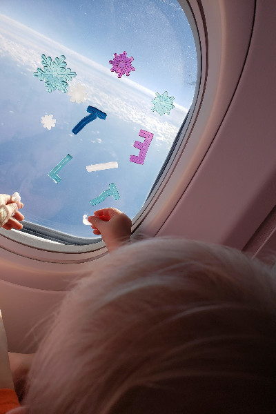 Toddler at plane window