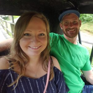 couple sitting together in old fashion care at Knoebels, exploration motherhood
