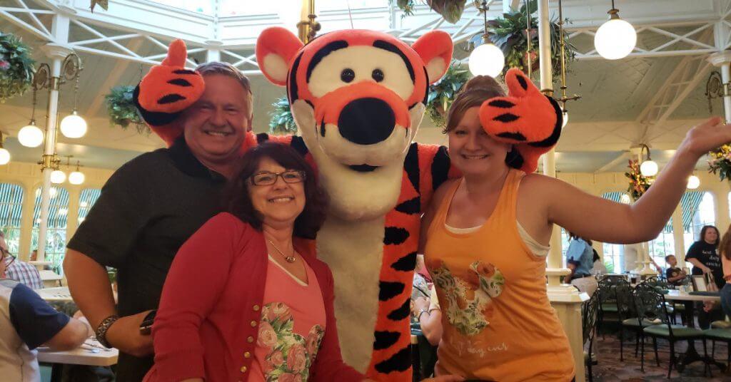 Family posing with Tigger at Crystal Palace