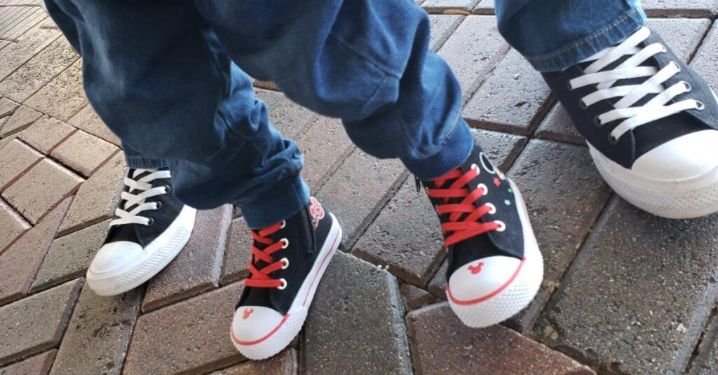 adult and toddler feet in high top sneakers, exploration motherhood
