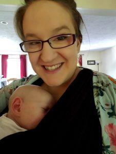 Mom babywearing infant in boba wrap Exploration Motherhood