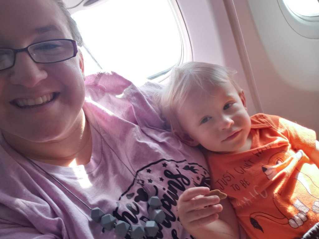 mom and toddler on a plane, explorationmotherhood.com