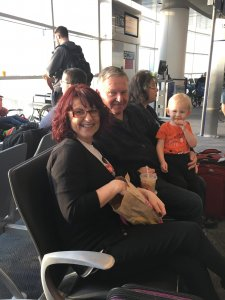 toddler and grandparents in airport, Exploration Motherhood