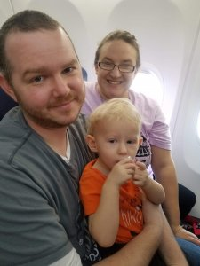 mom, dad, and toddler on plane explorationmotherhood.com
