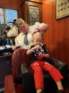 Toddler at Harmony Barber Shop in Magic Kingdom