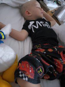 Toddler sleeping in Disney Hotel