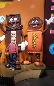 Child posing with Hershey's candy statues