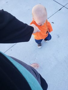 Mom and toddler walking together